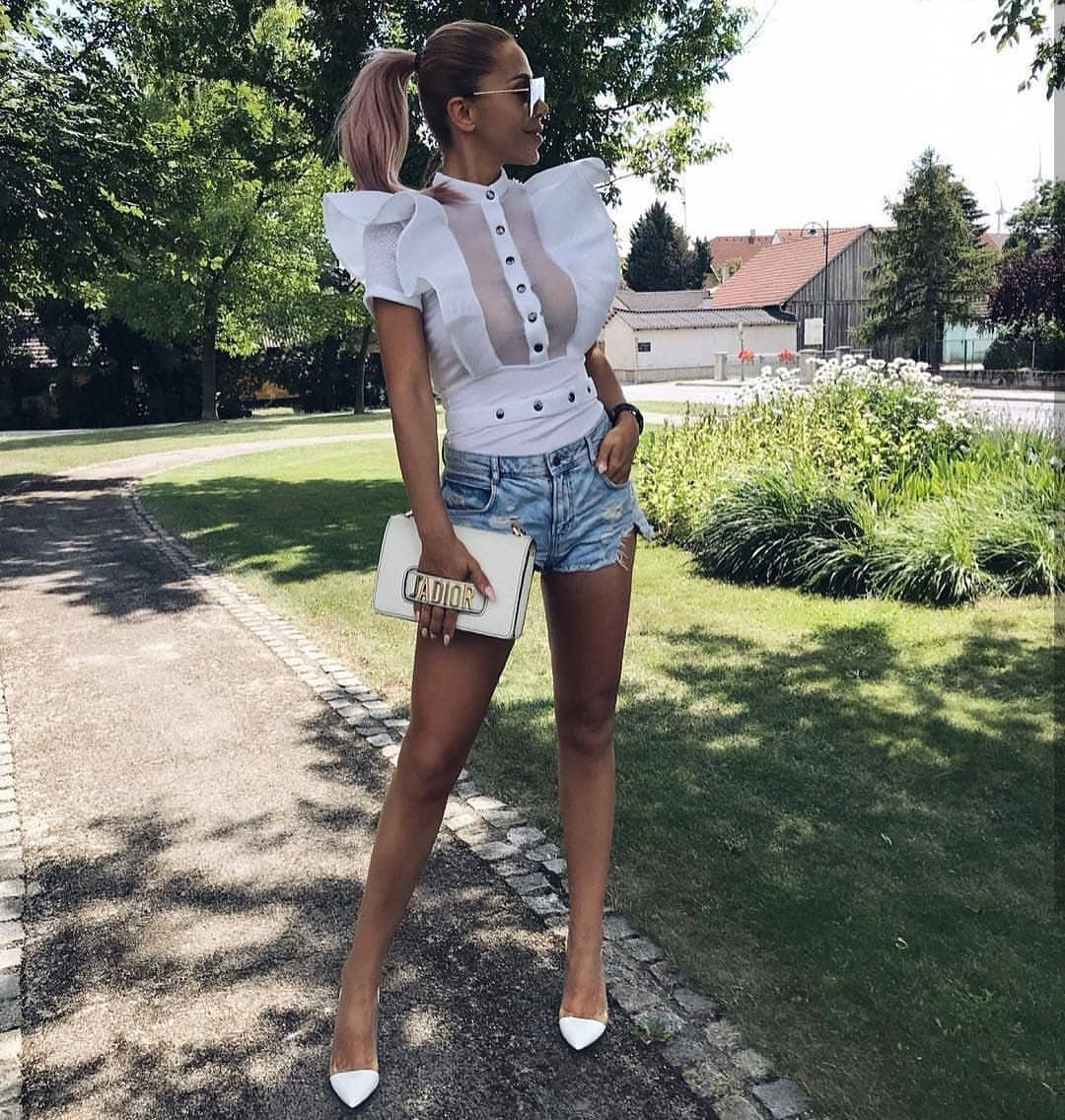 White Blouse With Ruffles And Wash Blue Denim Shorts For Summer 2020