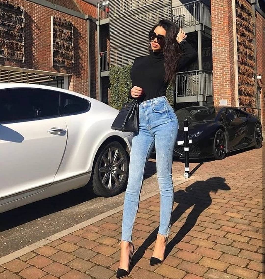 Black Slim Sweater And Blue Skinny Jeans For Spring 2019