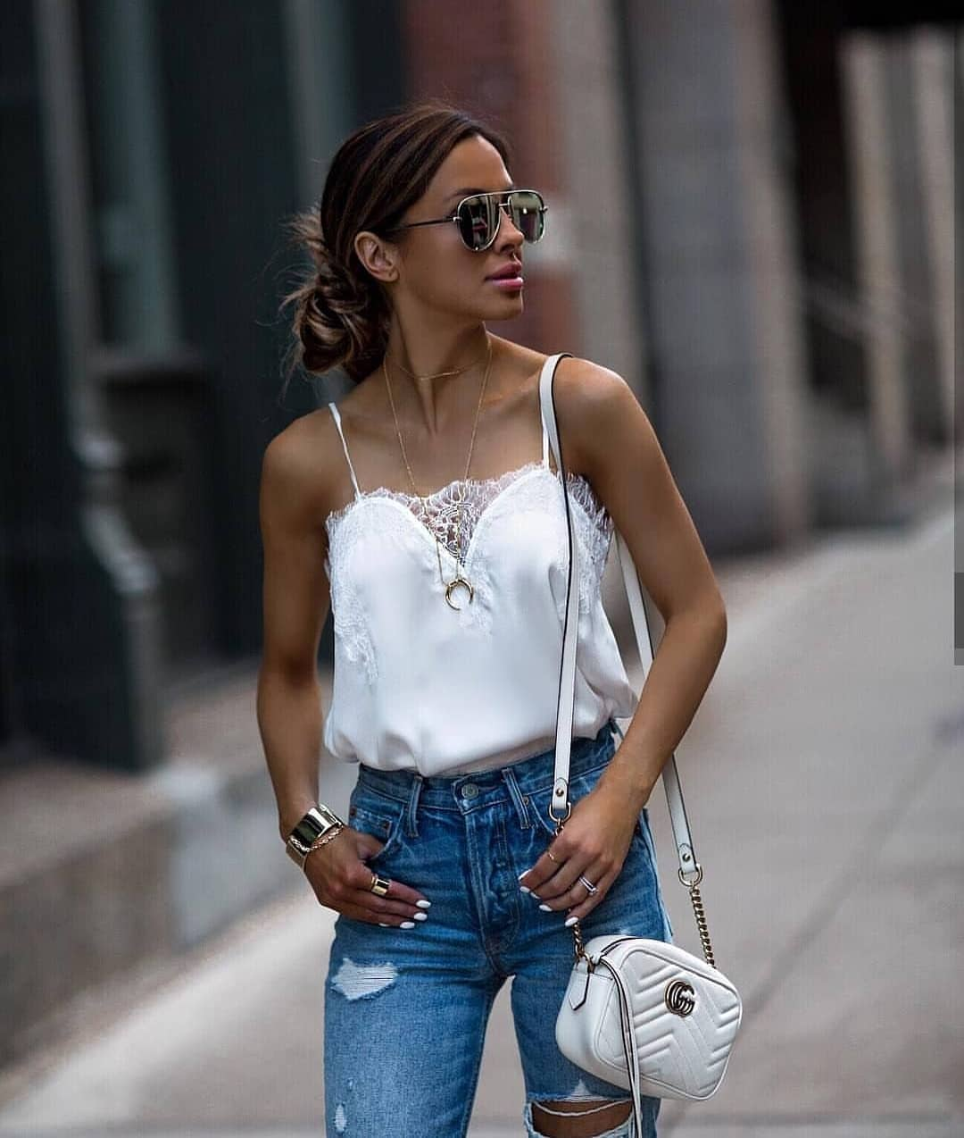 White Silk Slip Tank Top With Lace Details Tucked In Blue Jeans For Summer 2020