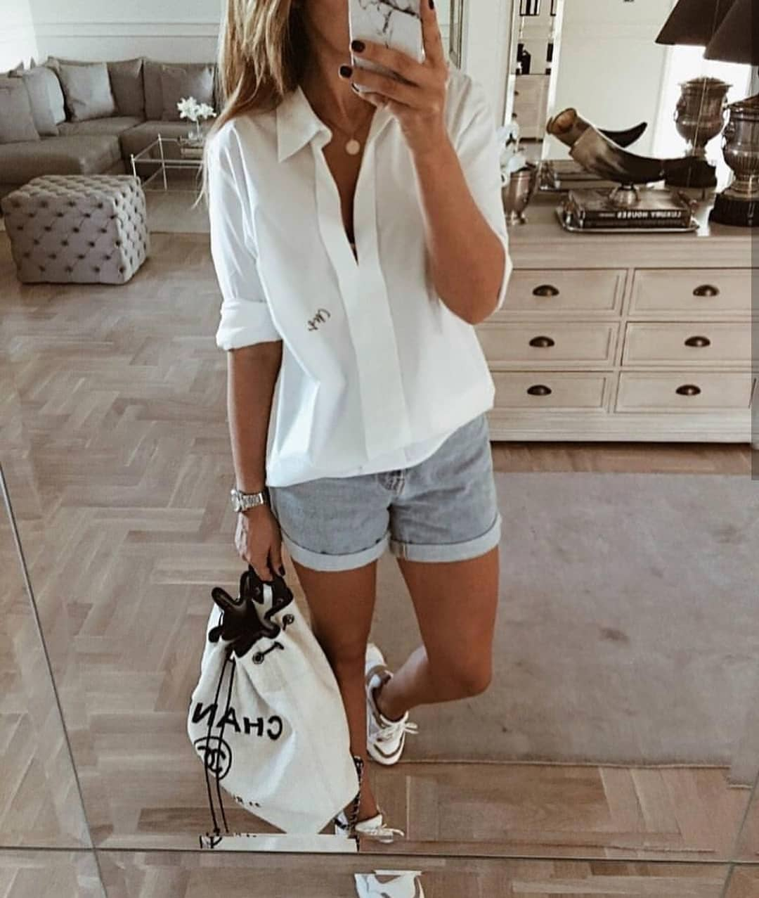 Silk Shirt In White With Denim Shorts And White Sneakers For Summer 2019