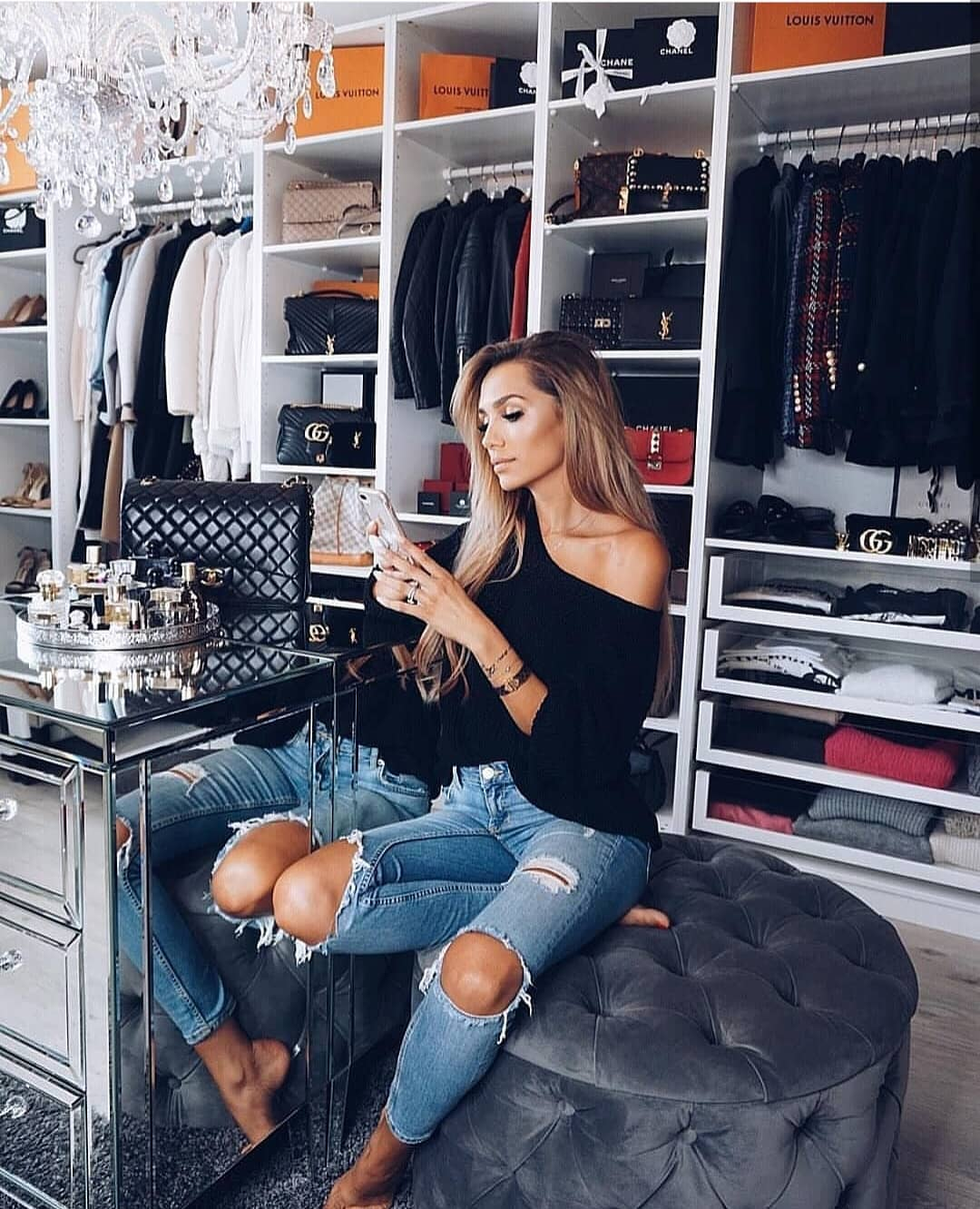 One Shoulder Black Top And Knee Ripped Jeans In Blue For Spring 2019