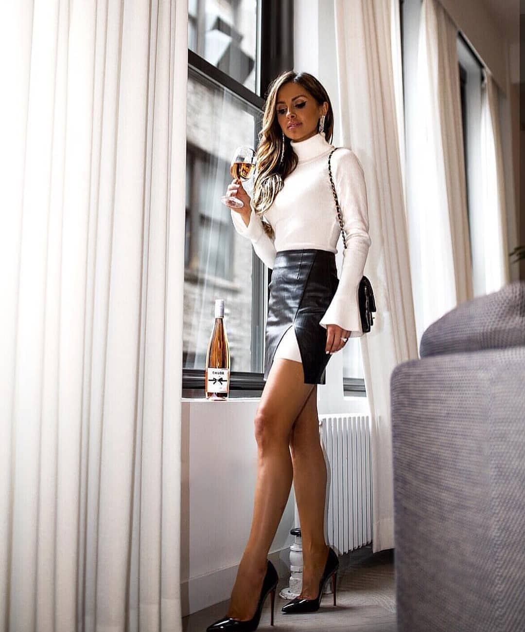 White Turtleneck With Bell Sleeves And Black Leather Mini Skirt For Spring 2019