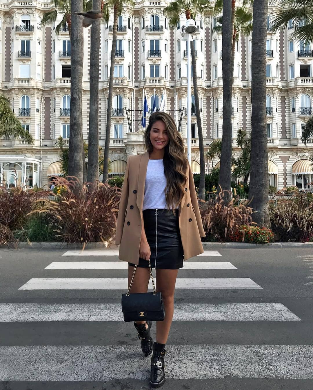 Camel Blazer With White Tee And Black Leather Mini Skirt For Spring 2020