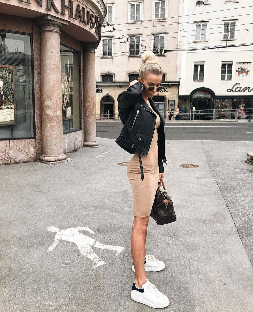 Cream Beige Skin Tight Dress With Black Leather Jacket And White Kicks For Fall 2019