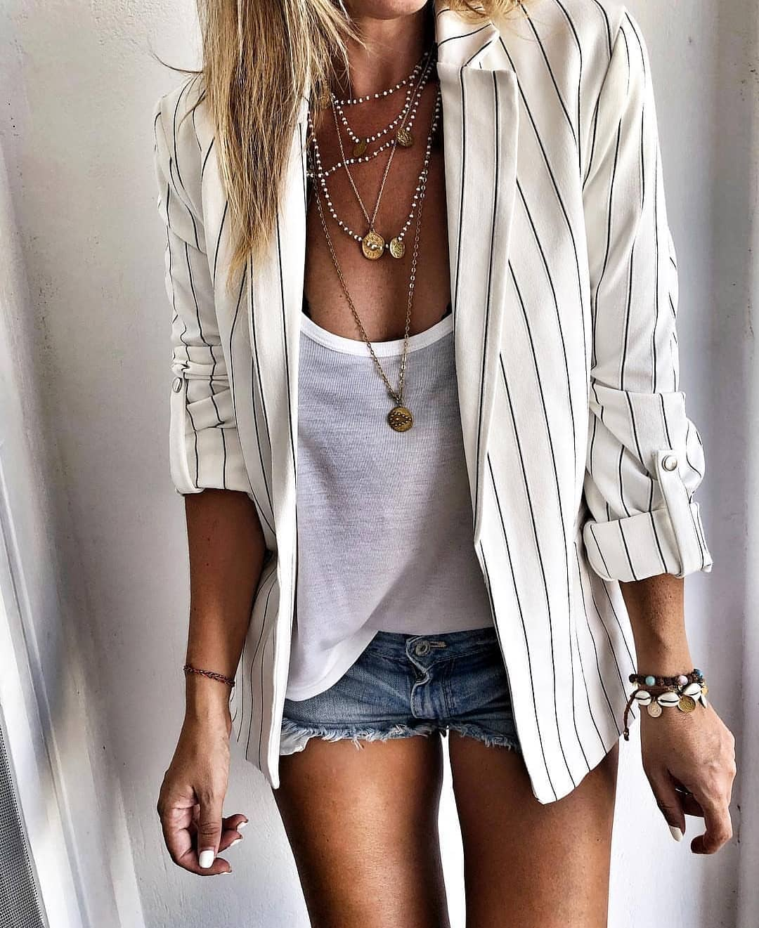 Pinstripe White Blazer And White Tee Teamed With Denim Cut Offs For Summer 2019