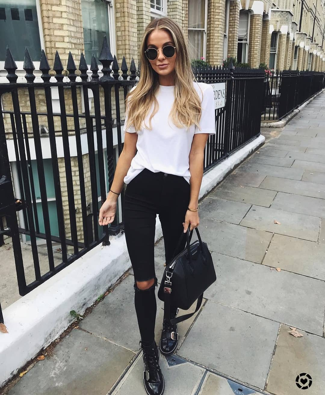 White Tee And Knee Ripped Jeans In Black For Spring 2020