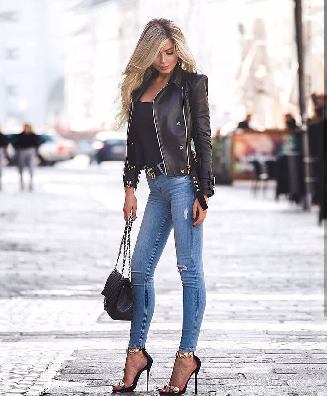 Black Leather Jacket And Skinny Jeans In Blue For Spring 2019