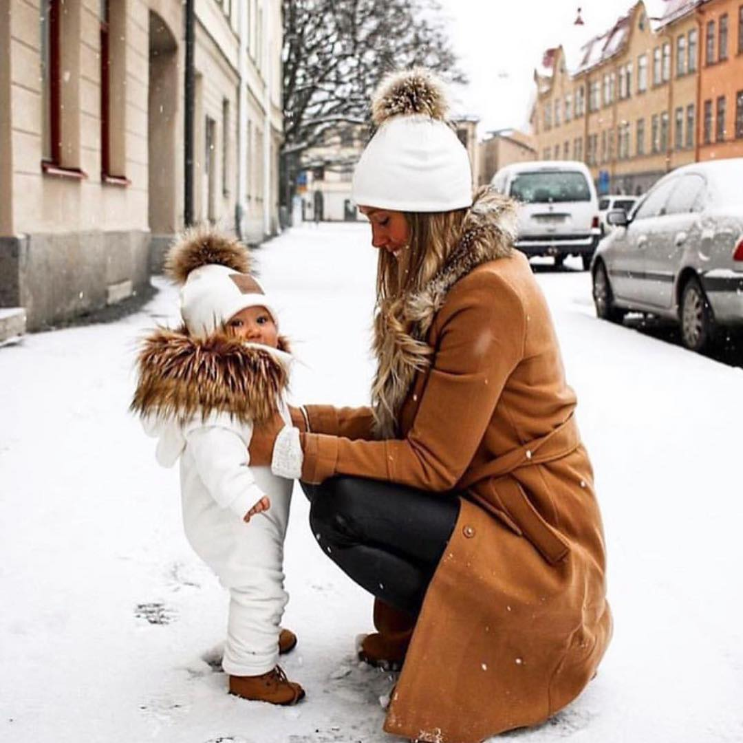 White Beanie Hat With Fur Pom And Camel Coat With Fur Collar For Winter 2021