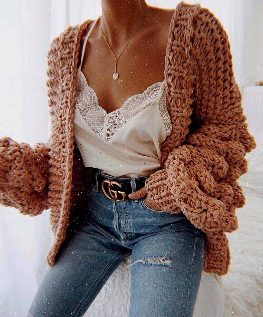 Chunky Knit Cardigan With White Sliptank top Tucked in Blue Jeans 2019